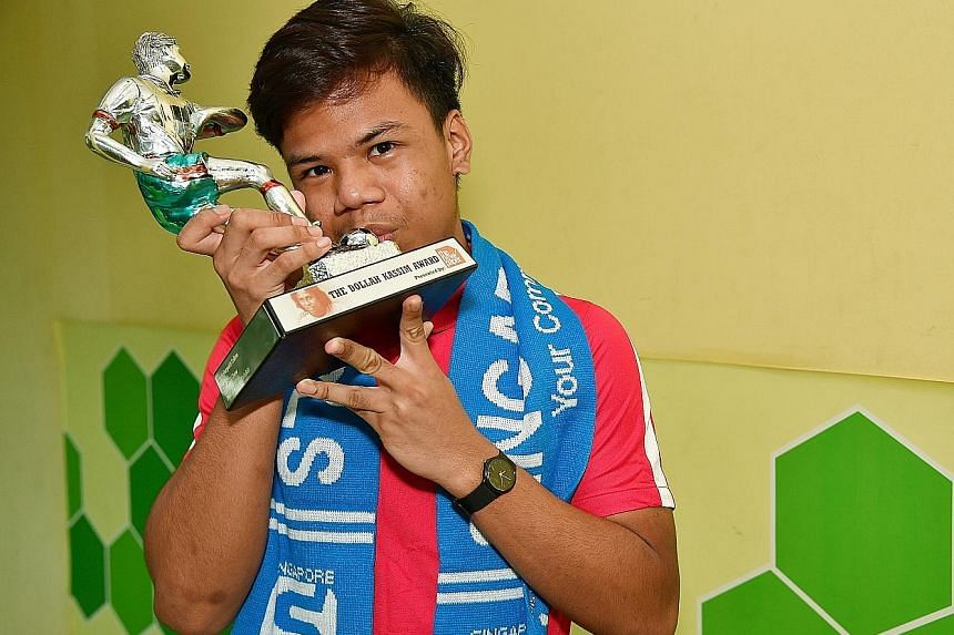 Nur Adam Abdullah, 17, with the TNP Dollah Kassim Award. It was his second nomination and he did not have high hopes.