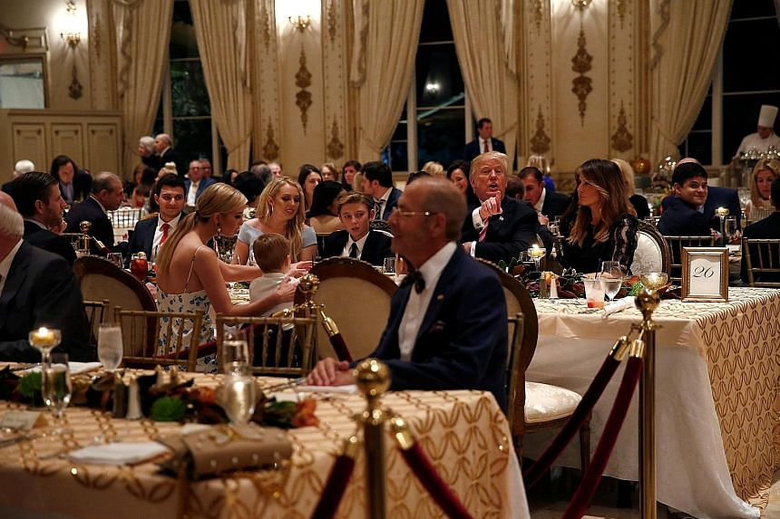 US President Donald Trump and First Lady Melania Trump having Thanksgiving dinner with their family at his Mar-a-Lago resort in Florida on Thursday. Asked what he was most thankful for - a question that for commanders-in-chief usually prompts praise