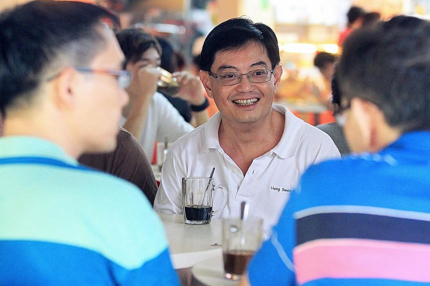 """Mr Heng Swee Keat, an MP for Tampines GRC, meeting residents at a coffee shop in Tampines in 2011. Mr Heng has said he hopes to be """"able to engage Singaporeans from all walks of life""""."""