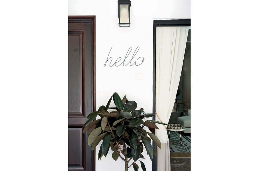"""A playful greeting to visitors - a """"hello"""" sign in cursive typeface."""