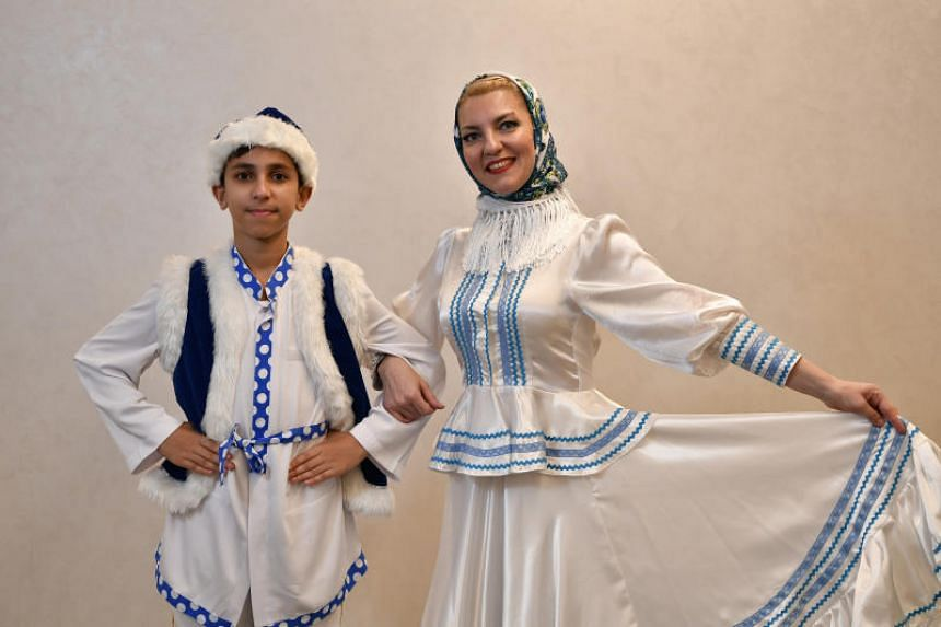 Ms Lioudmila Terentieva , who founded a Russian folk dance school, and her son, Aaron Singh Sirna.