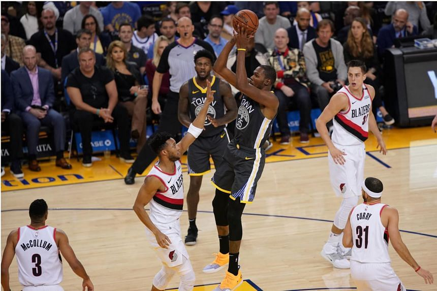 The Golden State Warriors' Kevin Durant scored 14 of his game-high 32 points in a second-quarter run-away.