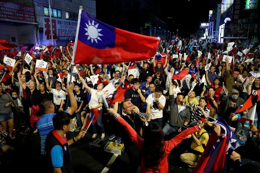 Supporters of the opposition Kuomintang's Kaohsiung mayoral candidate Han Kuo-yu celebrate the announcement of a leading trend during local elections in the poll, in Kaohsiung on Nov 24, 2018.