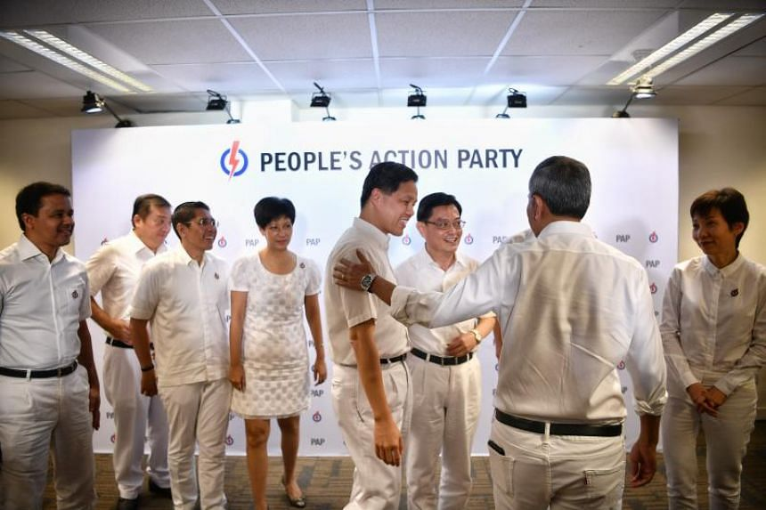 Members of the People's Action Party's fourth-generation leadership team (from left) Sitoh Yih Pin, Maliki Osman, Indranee Rajah, Chan Chun Sing, Heng Swee Keat, Vivian Balakrishnan (back to camera) and Grace Fu after the press conference at the