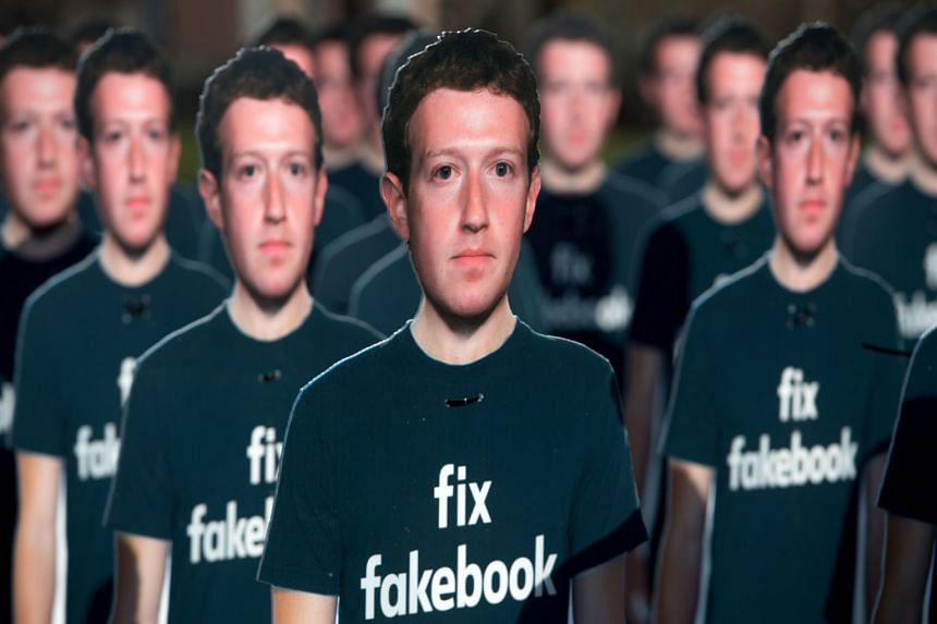 Cardboard cutouts of Facebook's Zuckerberg stand outside the US Capitol in April 2018.