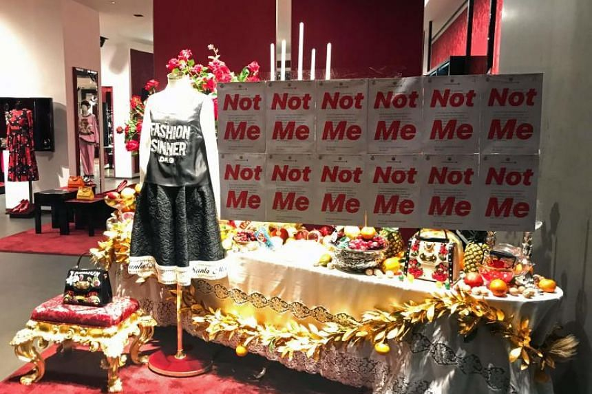 A protest banner on the window of a Dolce   Gabbana store in Shanghai. The 5120e431fc86