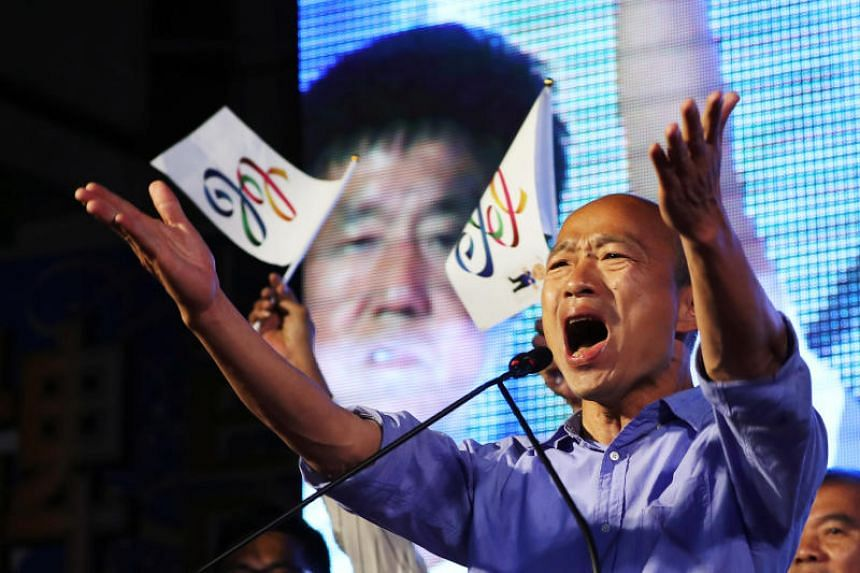 Kuomintang's Kaohsiung mayoral candidate Han Kuo-yu (above) took some 828,000 votes to the 691,000 votes of the Democratic Progressive Party's Chen Chi-mai, tallies by various Taiwanese broadcasters showed.
