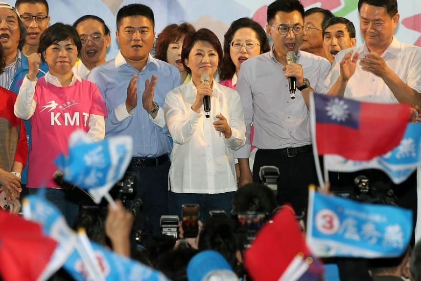 In Taichung, Kuomintang's Lu Shiow-yen (centre) beat incumbeat mayor Lin Chia-lung by a surprisingly large margin of 200,000 votes.