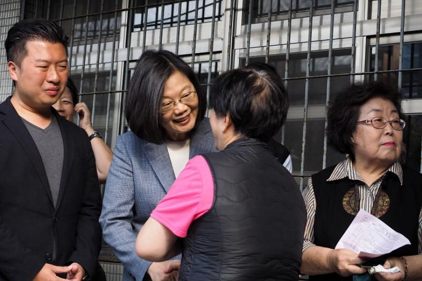 Taiwan's President Tsai Ing-wen queueing to vote in local elections in Taipei on Nov 24, 2018.