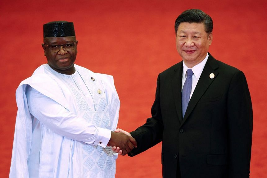 Sierra Leone's President Julius Maada Bio shakes hands with China's President Xi Jinping during the Forum on China-Africa Cooperation at the Great Hall of the People in Beijing on Sept 3, 2018