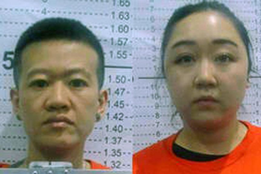 The four suspects Zhang Chuquan, Zhang Chuning, (left) Wang Xue and (right) Zhang Xixi, and in custody at a police station in Makati.