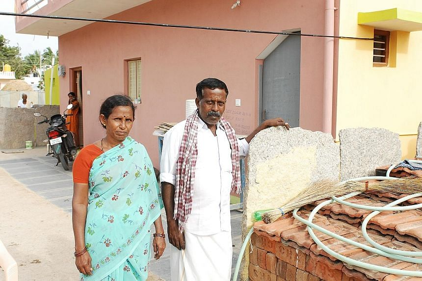 The world's largest solar farm, Shakti Sthala, is the size of more than 8,000 football fields and will have a capacity of 2,000 megawatts when completed by July next year. Mr K. Ramachandra and his wife Narayanamma in front of the house they have con