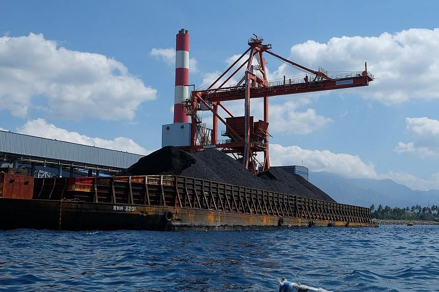 A mini mountain of coal bound for the Celukan Bawang power plant in Bali. Indonesia has abundant coal reserves to fuel growth but with that comes concerns about air pollution and greenhouse gas emissions. Fishermen near the Celukan Bawang power plant