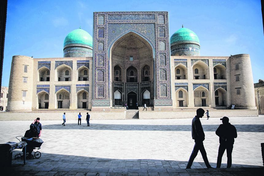 The Mir-i-Arab Madrasa in Bukhara, a city in Uzbekistan where glistening turquoise domes, ornate mosques, ancient forts and layer upon layer of living history dot the landscape. Left: Old-world charm mixes with modern-day glitz in Baku, capital of Az