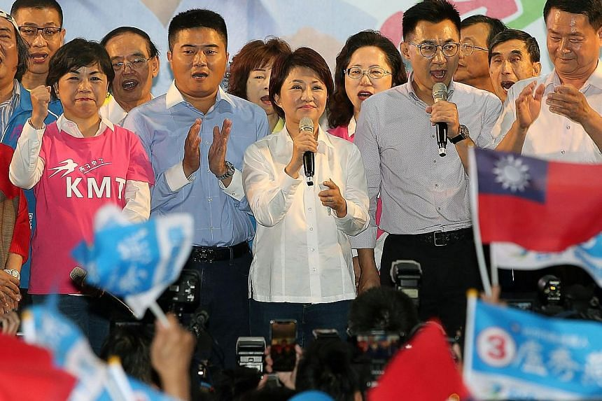 Ms Lu Shiow-yen from the opposition KMT speaking after her victory in the race to be Taichung mayor last night. Mr Han Kuo-yu of the opposition KMT acknowledging the crowd's cheers after winning the race to be mayor of Kaohsiung.