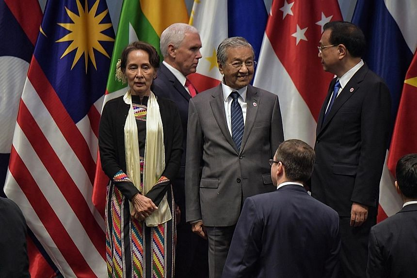 From left: Myanmar State Counsellor Aung San Suu Kyi, US Vice-President Mike Pence, Malaysian Premier Mahathir Mohamad and China Premier Li Keqiang at the 13th East Asia Summit in Singapore this month.