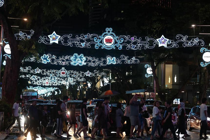 More than 20 Disney and Disney-Pixar characters such as Snow White and Cinderella, as well as the Toy Story characters Woody and Rex, can be seen on the arches that span Orchard Road at this year's light-up.