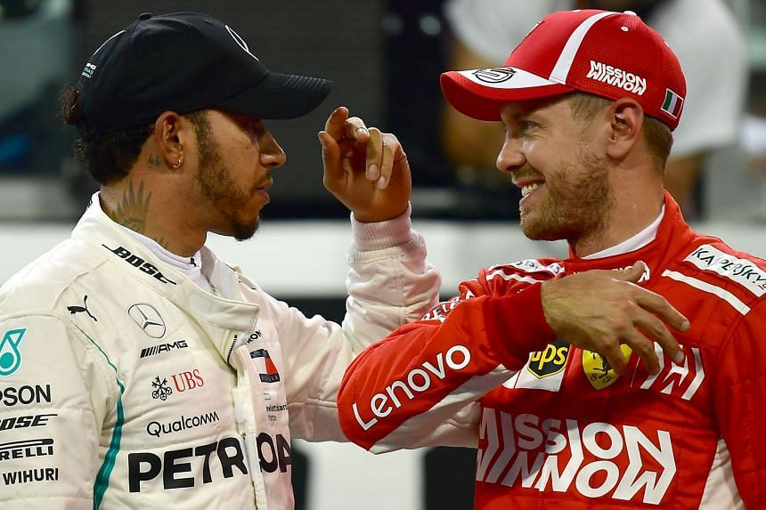 Hamilton (left) slap hands with Vettel after taking pole for the Abu Dhabi Grand Prix.