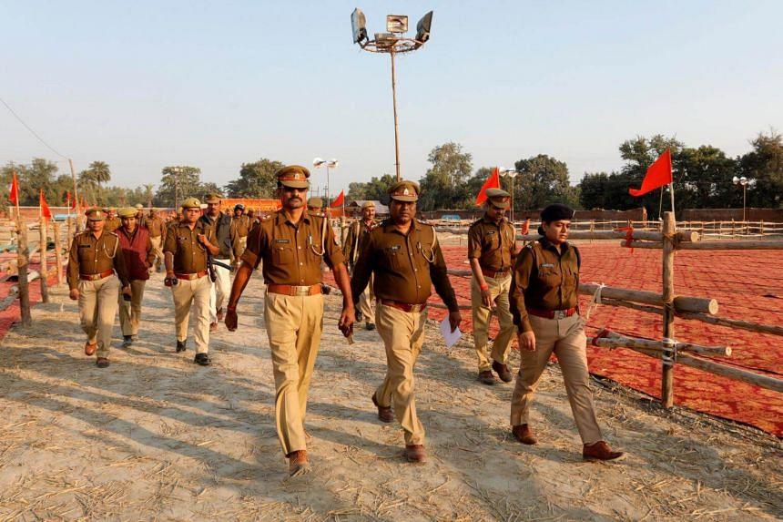 Police officers patrol the venue of a religious congregation organised by the Vishwa Hindu Parishad, a Hindu nationalist organisation, in Uttar Pradesh, India, on Nov 24, 2018.