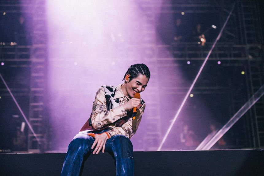 Taiwanese Mandopop star Jam Hsiao sitting on the stage at his Mr Entertainer concert in Singapore on Saturday night (Nov 24).