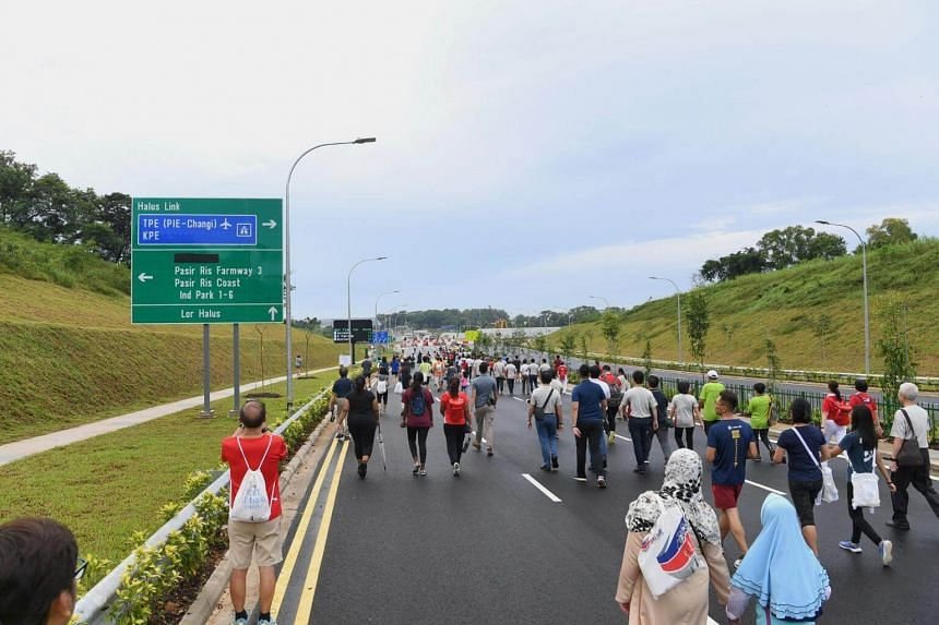 Residents walking on the new Punggol Central road extension, on Nov 25.