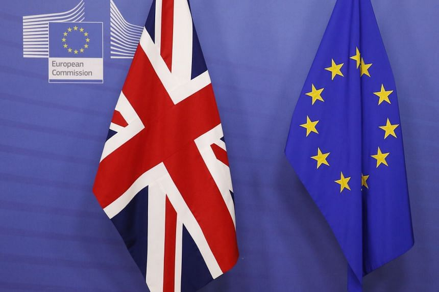 The flags of Britain and the EU are seen before a meeting between British PM Theresa May and European Commission President Jean-Claude Juncker in Brussels, on Nov 24, 2018.