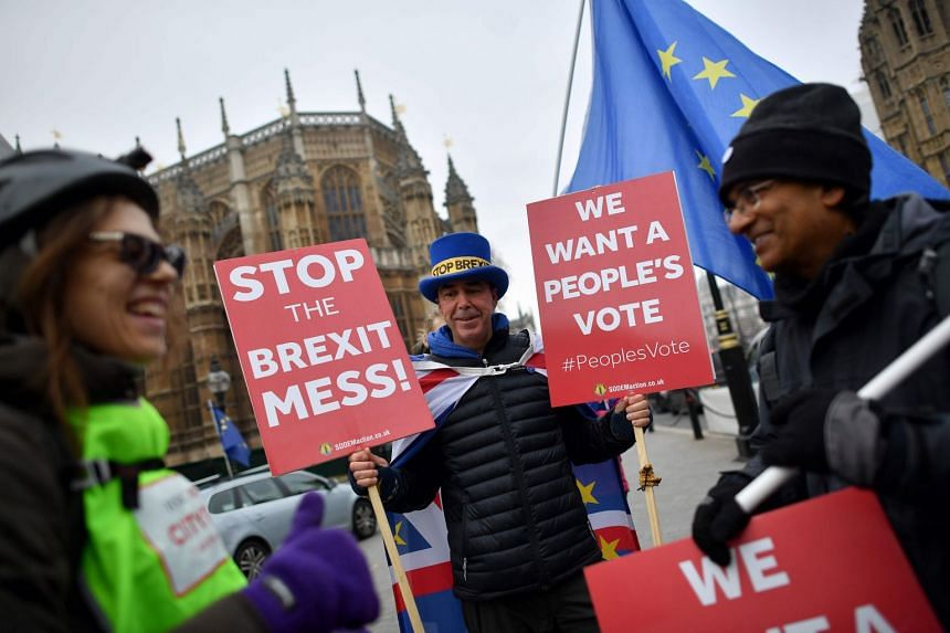 Anti-Brexit demonstrators protesting outside the Houses of Parliament in central London on Nov 22, 2018.