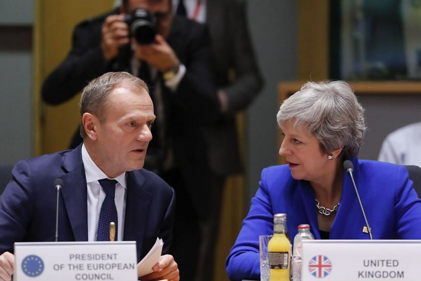 British Prime Minister Theresa May and European Union Council President Donald Tusk talking during the European council in Brussels, Belgium, on Nov 25, 2018.