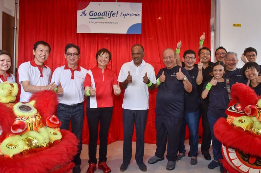 Law and Home Affairs Minister K. Shanmugam tours GoodLife!@Yishun centre while residents receive hand massages and aromatherapy sessions.