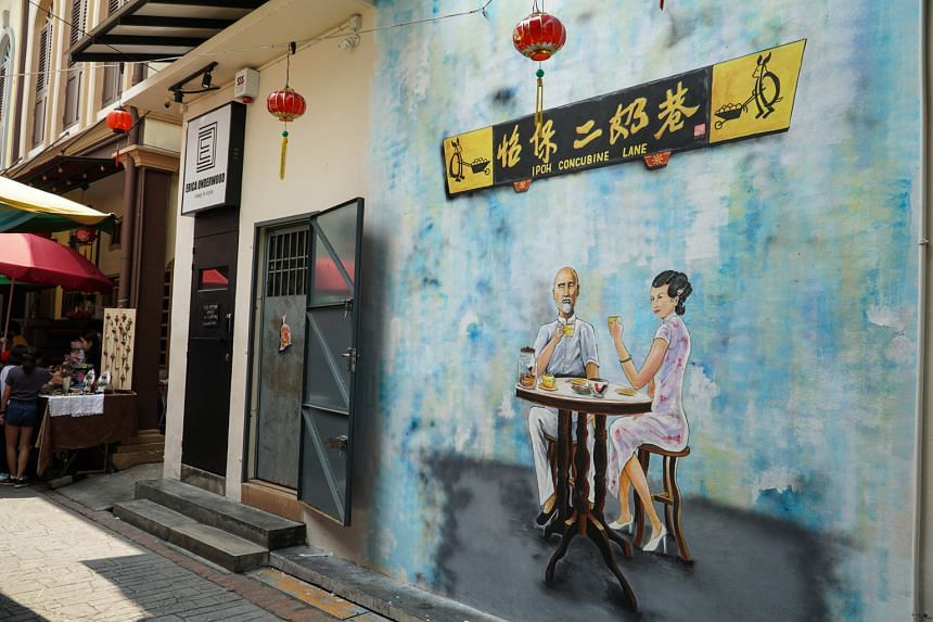 Go on a self-guided art walk to check out the murals and art installations (above) that adorn Ipoh's alleys.
