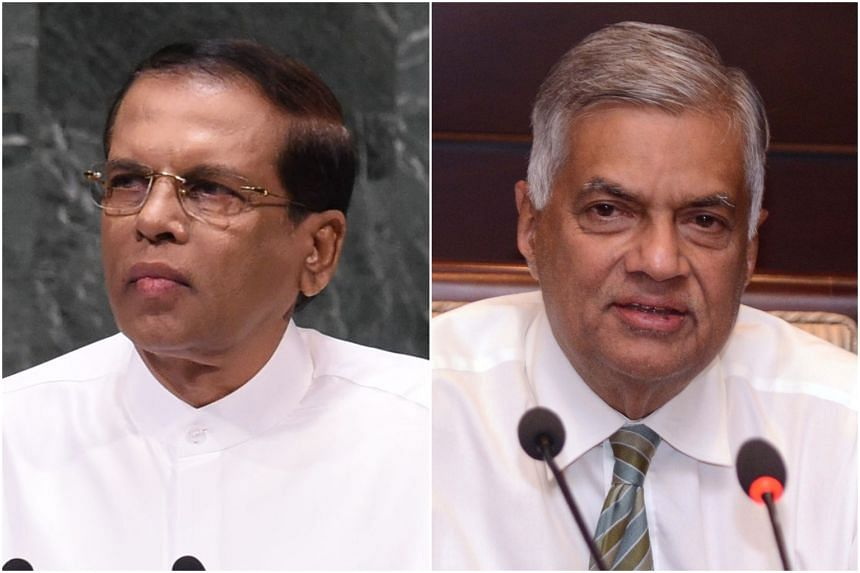 Sri Lankan President Maithripala Sirisena (left) has vowed he will never reappoint arch-rival Ranil Wickremesinghe as prime minister.