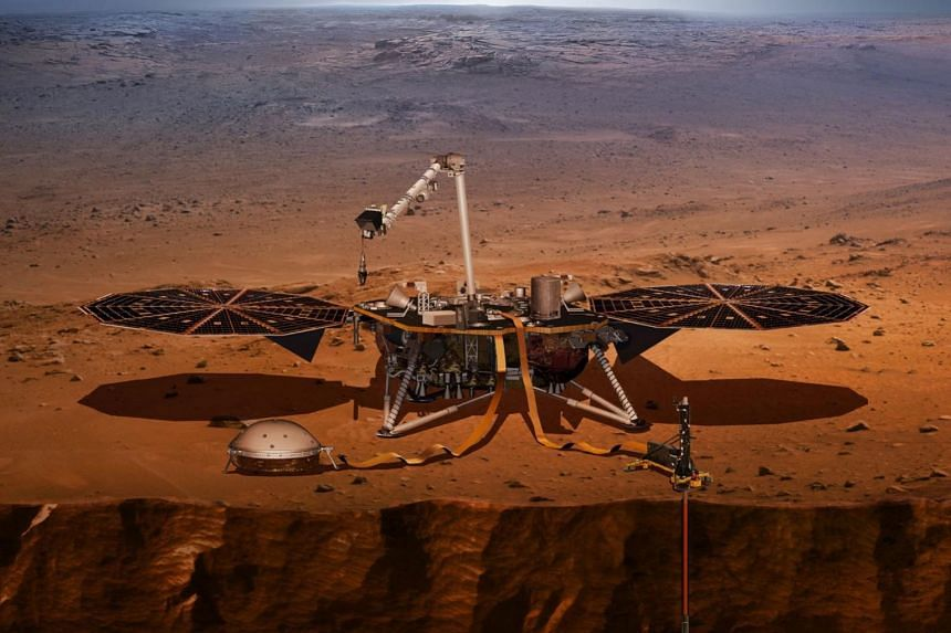 """An artist's impression of Nasa's InSight lander probing the """"Inner Space"""" of Mars."""