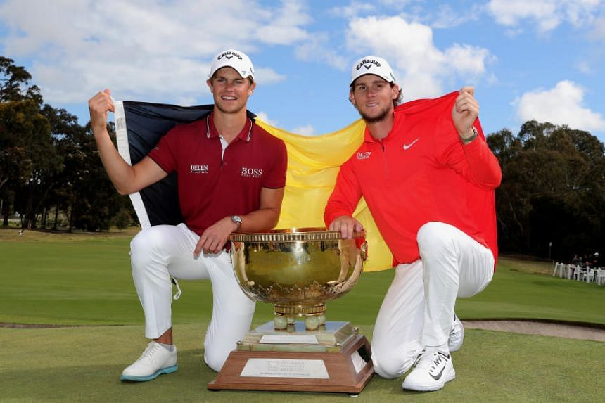 Thomas Detry and Thomas Pieters of Belgium posing with the trophy and their national flag after winning the World Cup of Golf, in Melbourne, Australia, on Nov 25, 2018.