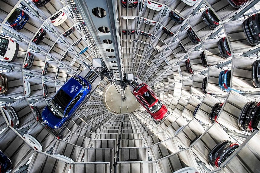 Volkswagen's cars at the storage-facility auto tower at the company headquarters in Wolfsburg, Germany. Porsche plans to streamline its operations over the next eight years and invest more to develop and manufacture electric cars.