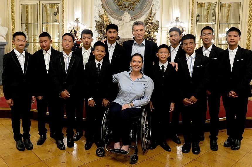 Thai football team Wild Boars with Argentinian President Mauricio Macri (standing) and Vice-President Gabriela Michetti (seated) on a visit to Buenos Aires last month. The Cave, Nang Non is slated for release next year.