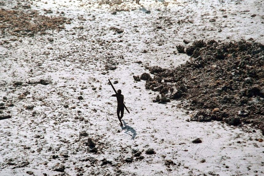 Mr John Allen Chau broke Indian law that prevents access to North Sentinel Island and slipped past layers of security, including a 5km buffer zone around it. A photo taken on Dec 28, 2004, after the tsunami shows a Sentinelese aiming his bow and arro
