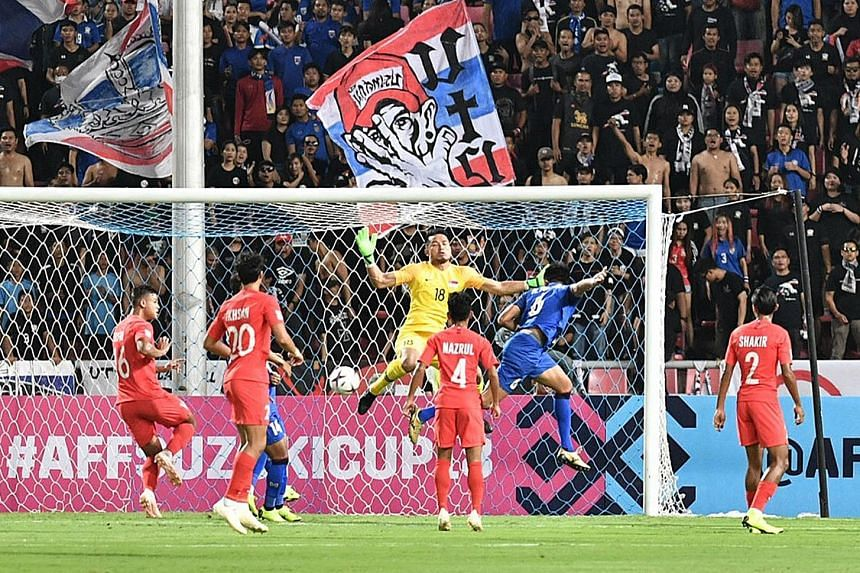 Defender Irfan Fandi (left) is just about to hook the ball into his own net to give Thailand the lead in the AFF Suzuki Cup at the Rajamangala Stadium. The Lions never recovered from the 12th-minute setback.