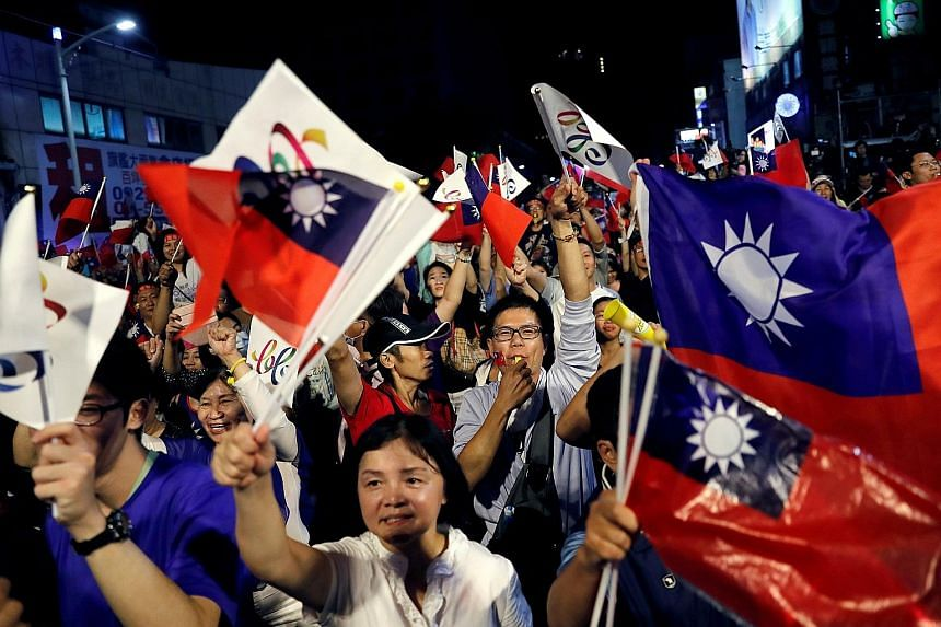 """Supporters of Kaohsiung mayoral candidate Han Kuo-yu of the opposition KMT celebrating his victory in Kaohsiung on Saturday. """"Han Kuo-yu was the fuse that ignited the people's unhappiness with DPP,"""" said one political commentator."""