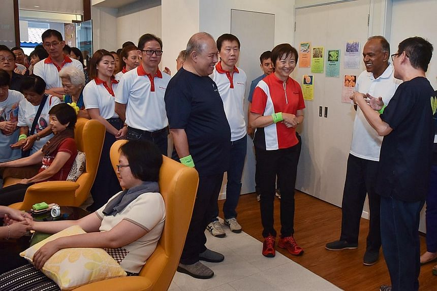 Home Affairs and Law Minister K. Shanmugam touring the GoodLife!@Yishun centre with Nee Soon GRC MP Lee Bee Wah (in red shirt) and Brother Dominic Yeo Koh (next to her in dark-coloured shirt), who sits on the board of directors of Montfort Care, whic