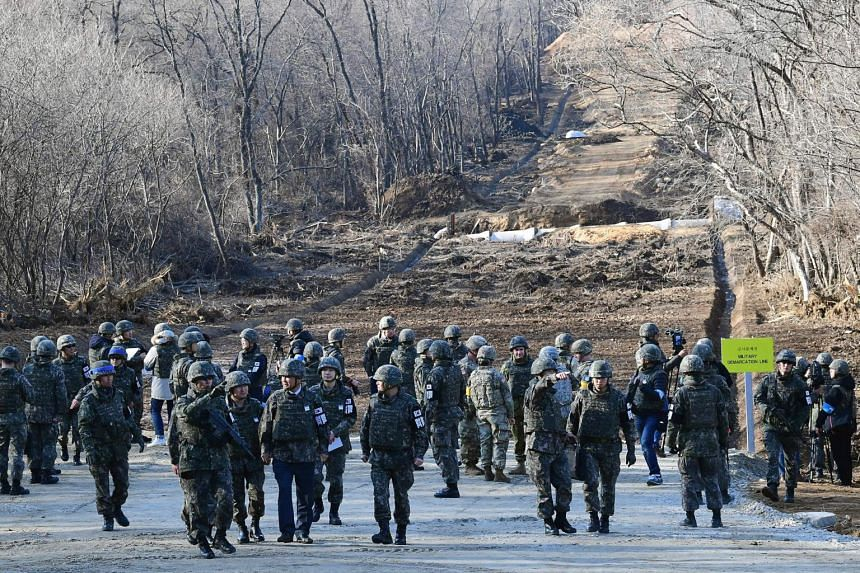 South Korean soldiers gather at Arrowhead Ridge as a tactical road is built across the military demarcation line inside the Demilitarized Zone, in Cheorwon on Nov 22, 2018.