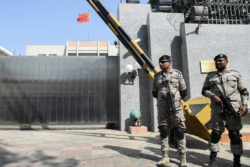 Pakistani rangers stand in front of the Chinese consulate after an attack in Karachi, on Nov 23, 2018.