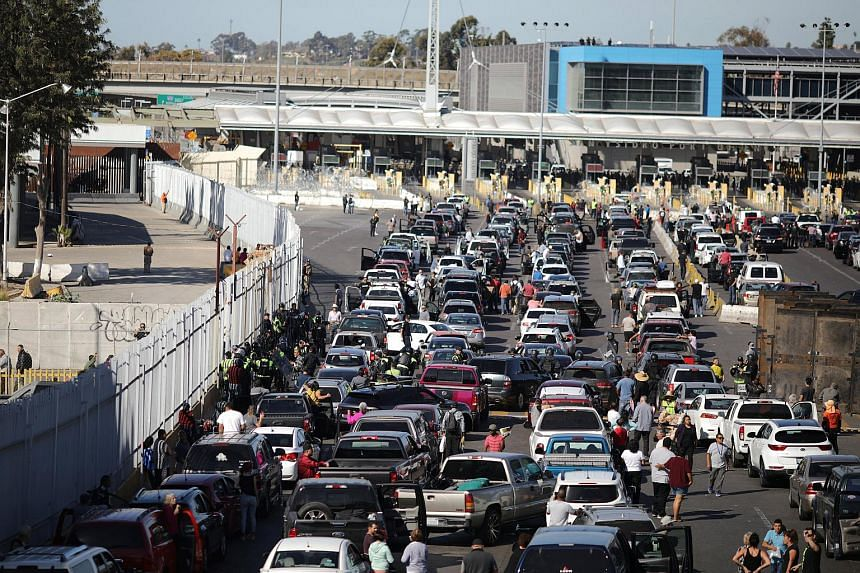 The US authorities have re-opened the San Ysidro port of entry into Mexico after it was closed to prevent a caravan of thousands traveling from Central America from crossing