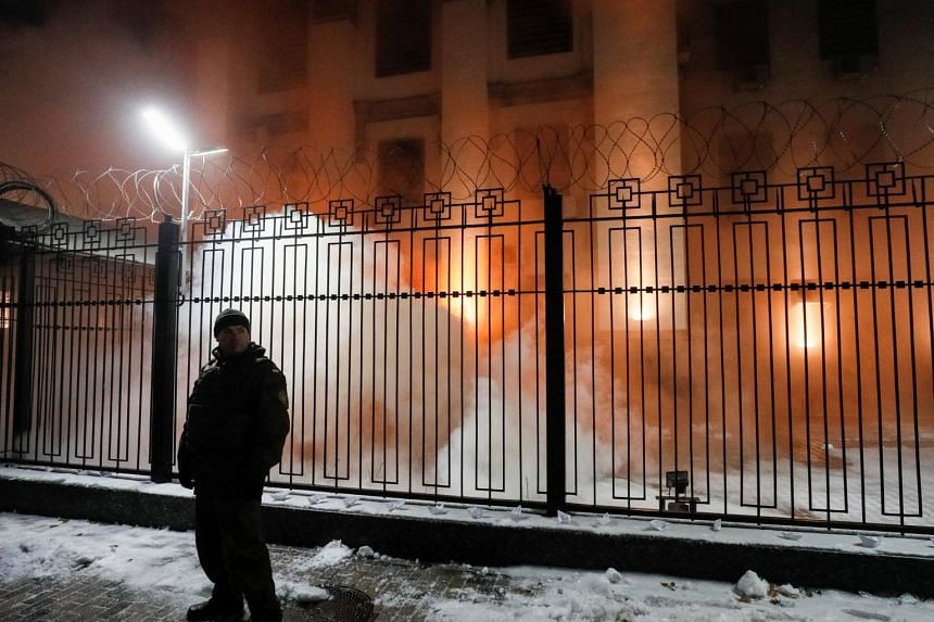 Smoke from a flare thrown by a protester is seen during a rally against the seizure by Russian special forces of three Ukrainian navy ships, in front of the Russian embassy in Kiev, Ukraine, on Nov 25, 2018.