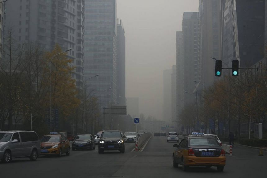 "China, the world's biggest source of climate-warming carbon dioxide, has pledged to halt its rise in emissions by ""around 2030""."