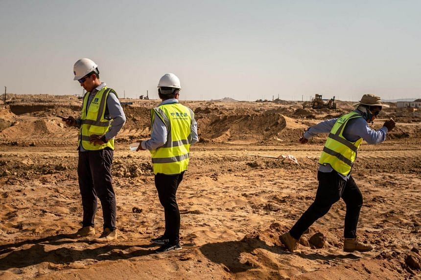 Chinese surveyors at the future site of the central business district in Cairo, Egypt, on Aug 9, 2018.
