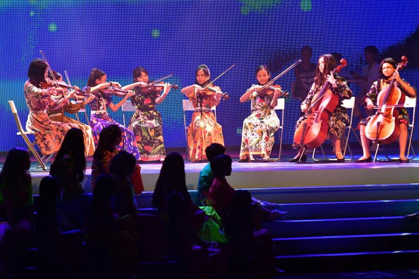 A string ensemble of eight girls playing an instrumental version of Melody Fair by The Bee Gees.