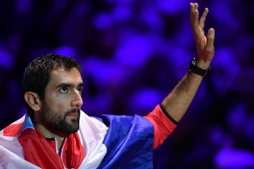 Croatia's Marin Cilic waves to the crowd as he celebrates after victory over France's Lucas Pouille (not pictured) in their singles rubber for the Davis Cup final tennis match at The Pierre Mauroy Stadium in Villeneuve-d'Ascq, northern France, on Nov