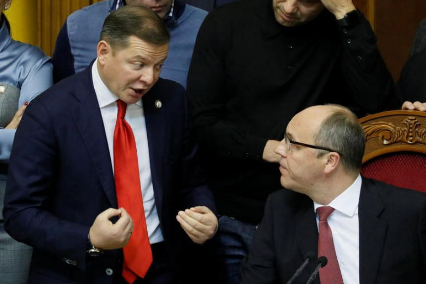 Radical party leader Oleh Lyashko (left) and Speaker Andriy Parubiy during a Parliament session to review a proposal by Ukrainian President Petro Poroshenko to introduce martial law for 60 days on Nov 26, 2018.