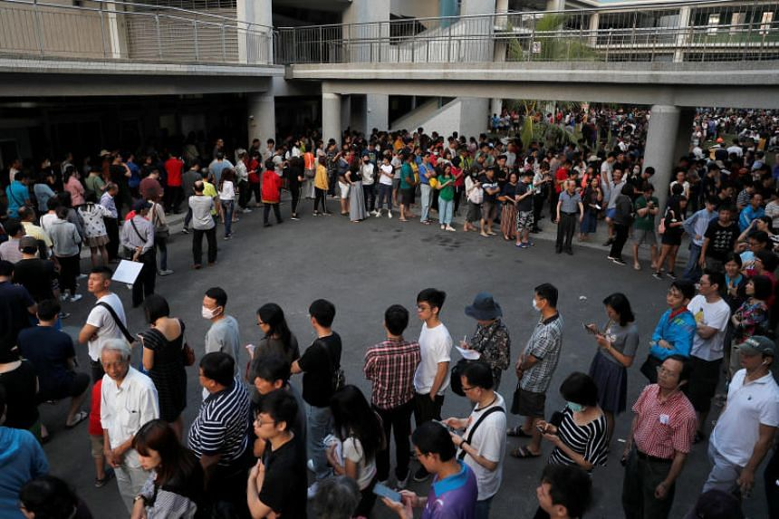 People queue to cast their votes at a polling station during local elections and a referendum on same-sex marriage, in Kaohsiung, Taiwan on Nov 24, 2018.