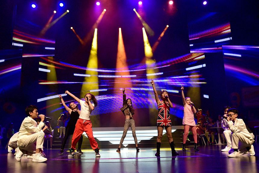 ChildAid performers singing Bring It All Back by S Club 7 at the concert last night. The group also performed the Backstreet Boys' I Want It That Way and the Spice Girls' Wannabe, with the five girls dressed in the Spice Girls' iconic outfits, and th